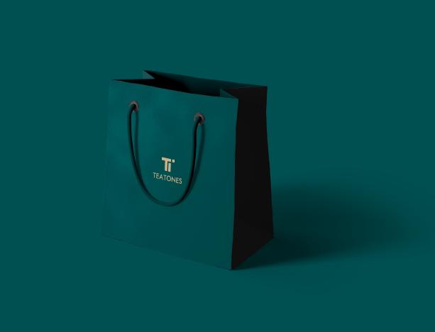 teatones dark green shopping bag with golden teatones logo